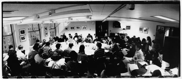 """The <em>Saturday Night Live</em> team meets for a read-through in 1994. Everyone has a designated seat: Lorne Michaels sits at the head of the table (between the windows) the host sits to his right, and the head writer to his left. <a href=""""http://media.npr.org/assets/img/2015/02/13/050a_saturday_night_live_va_04617_archive.jpg"""">Click to see a larger version of this image.</a>"""
