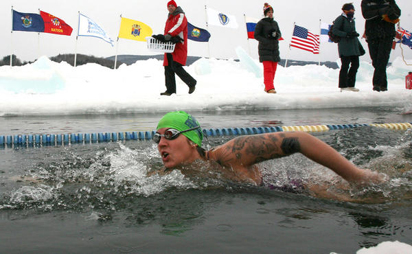 Daina Bouquin competes in the first U.S. Winter Swimming Championships on Saturday in Lake Memphremagog near Newport, Vt. The event drew swimmers from around the world to race in icy water that was below 32 degrees F.