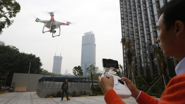 A staff member from DJI Technology Co. demonstrates a drone in Shenzhen, in southern China's Guangdong province. A new website lets people request that drones stay away from their property.