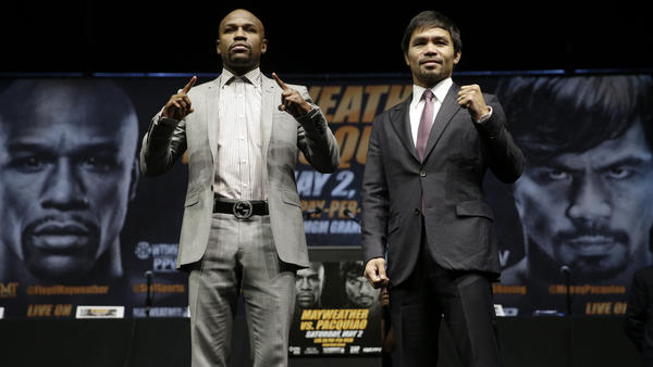 Floyd Mayweather Jr. (left) and Manny Pacquiao pose for photos after a news conference in Los Angeles. The two are scheduled to fight in Las Vegas on May 2.