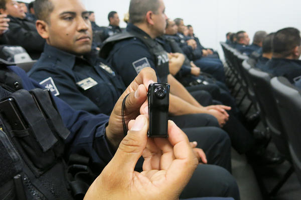 Tijuana police get a look at the new body cameras.