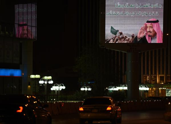 A billboard in Riyadh, the Saudi capital, features an image of soldiers and a portrait of Saudi King Salman.