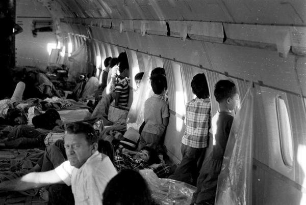 Children aboard this World Airways DC-8 jet were evacuated from Vietnam on April 2, 1975, shortly before the fall of Saigon and just two days before the first official Operation Babylift flight. Among the children was Thanh Jeff Ghar (center, lying by a window), 12.