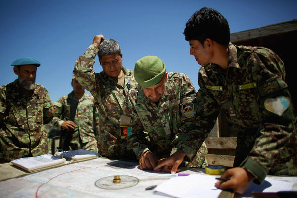 Afghan soldiers plot coordinates for their artillery strike against Taliban fighters in the hills of Nangahar Province.