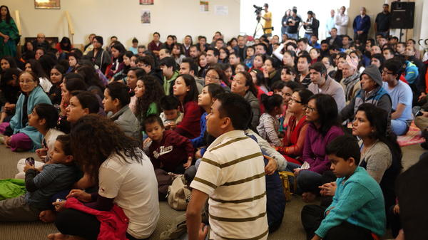 Members of the Nepalese community gather for a vigil and prayer service at a Hindu temple near Seattle.