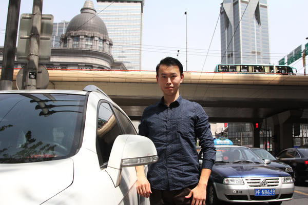 Joel Xu, 25, drives in Shanghai for People's Uber, a ride-sharing service. He makes about $4,000 a month – a good wage in Shanghai – and loves meeting new people he'd otherwise never encounter.
