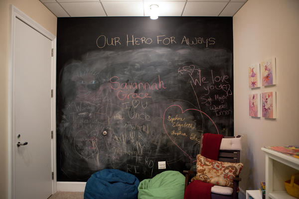 The children's room in the Center for the Families of the Fallen, where kids are encouraged to write their thoughts on the chalkboard wall.