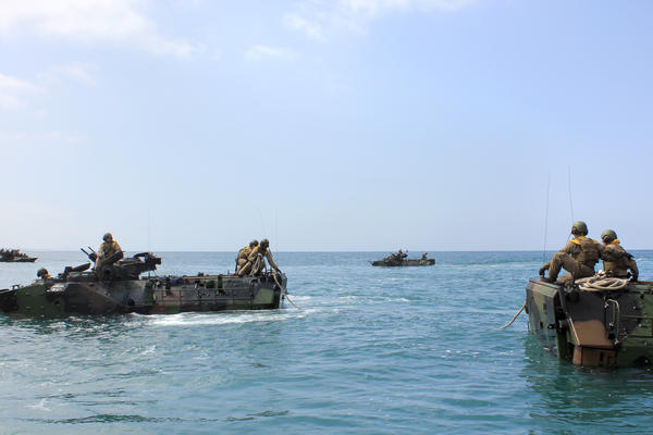 "Troops at sea do a towing exercise, where one vehicle is ""in distress"" and the other has to tow it using ropes."