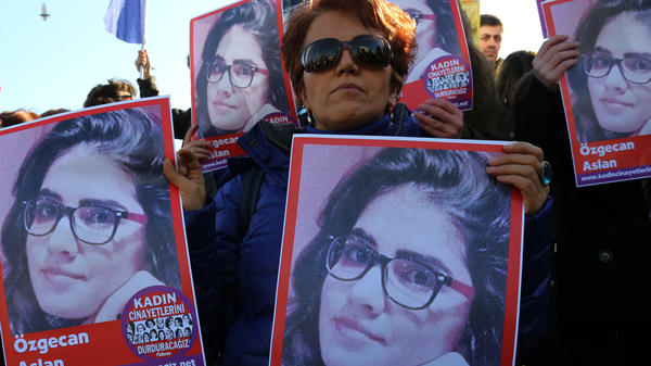 "Demonstrators in the Turkish capital of Ankara hold posters of Ozgecan Aslan, a 20-year-old student who was allegedly killed by a bus driver after fighting off a sexual assault. The posters read: ""End killings of women."""