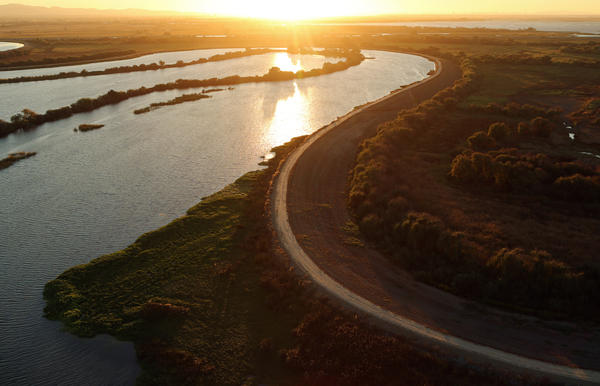 The sun sets over the Sacramento-San Joaquin River Delta near Rio Vista, Calif., in 2013. The delta is the largest West Coast estuary and a source of conflict over the state's water.<strong></strong>