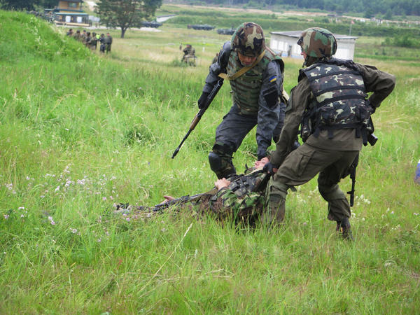 Ukrainian national guardsmen practice skills shared by U.S. trainers. A U.S. brigade commander says the mission is as much a learning experience for the Americans as it is for the Ukrainians.