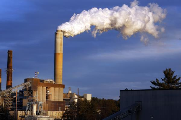 A plume of steam billows from the coal-fired Merrimack Station in Bow, N.H. in January 2015.