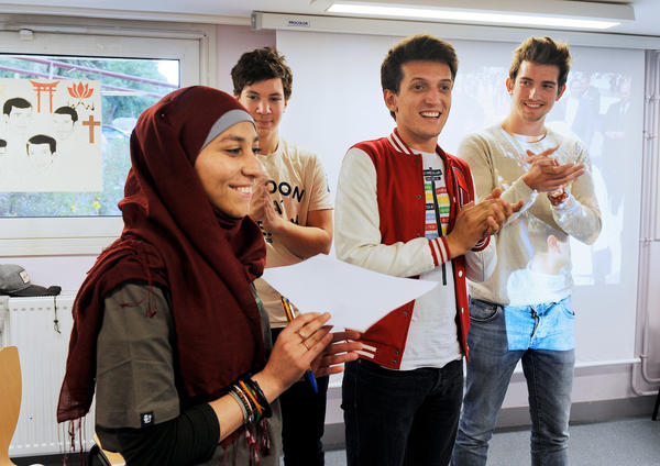 """Members of Coexister, (from left) Sabah Zouaghi, Ismael Medjoub, Samuel Grzybowski and Josselin Rieth, appear on June 2, 2014, in Le Mans, in western France. Members of the group took part in a 10-month """"interfaith tour"""" to 40 countries to meet religious communities."""