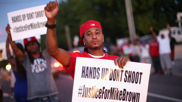 Demonstrators in St. Louis, Mo., protest the killing of  Michael Brown.