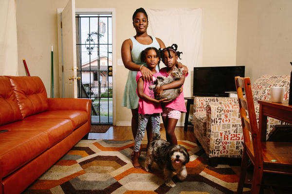 "Dyha Gresham (front, left), her older sister Briceshanay (in back) and Briceshanay's daughter Uri stand in their New Orleans home with the family's cat Sugar-Pepper and dog Selena. After Katrina, Briceshanay says, she relied on theater and the arts to help her ""move through terrible and difficult times."""
