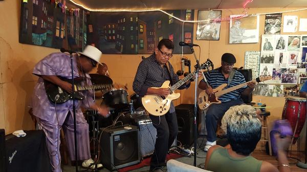 """All are welcome at Franklin Bell's weekly blues workshop, and the home-brewed event has its share of regulars. Left to right: Lester Lands (guitar), Willie T. Brooks (drums), Tony Ibarra (guitar), Leroy Martinez (bass), """"Mr. Wilson"""" (congas)."""