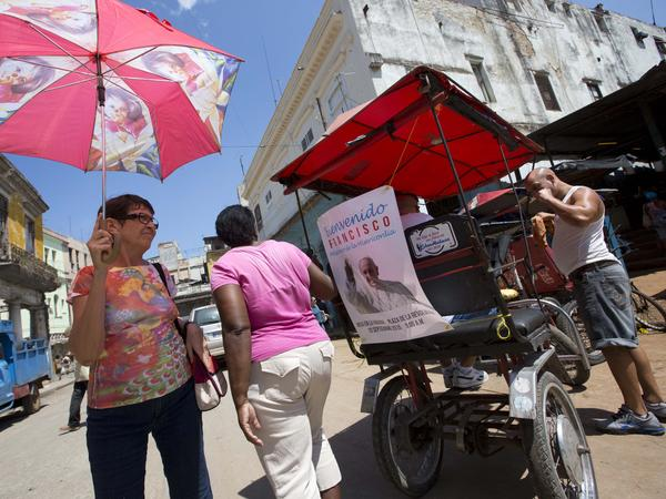 A photo of Pope Francis decorates the back of a tricycle taxi in Havana on Friday.