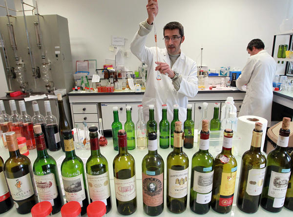 Lab workers test wine for authenticity in a lab run by the French Finance ministry in Bordeaux, southwestern France. Demand has driven up the price of wine, making conditions ripe for counterfeiters.