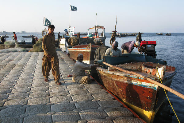 Fishermen at the harbor in Gwadar, a remote fishing town on Pakistan's southwestern coast. China is investing billions to create a large port in Gwadar and develop a transportation network that will lead to western China. It's part of the larger Chinese effort to build a modern Silk Road.