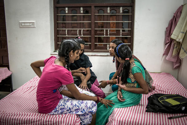 Bedtime at the Veerni Institute. Before turning in, the girls gossip about their day.
