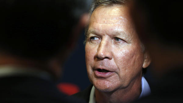 Ohio governor and Republican presidential candidate John Kasich speaks to reporters following an Americans for Peace, Prosperity and Security national security forum in Concord, N.H., in September.