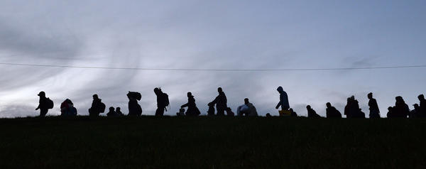 German police guide a group of migrants after they crossed the border between Austria and Germany near Passau, Germany, on Wednesday. The massive influx of migrants this year has stirred debate about Europe's open borders policy.