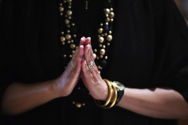 A woman prays at Basilica of the National Shrine of the Immaculate Conception in Washington, D.C. The shift away from religion among Americans has taken place in a relatively short period of time.