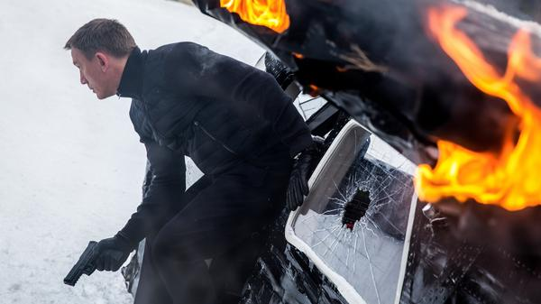 James Bond (Daniel Craig) is back in <em>Spectre.</em> It's everything Bond fans could want, and then some.