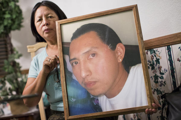 Carmen Cobian holds a photograph of her son, 26-year-old Christian Cobian, who was shot and killed by Los Angeles County Sheriff's deputies in January 2012. Cobian is among the 375 people shot by on-duty police officers between 2010 and 2014 in Los Angeles County.