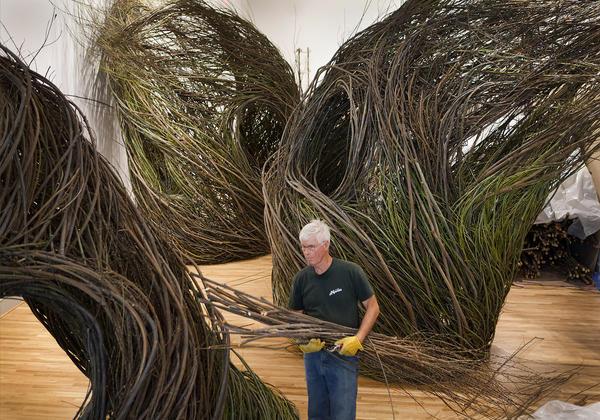 Stick sculptor Patrick Dougherty creates nests in his 2015 work <em>Shindig.</em>