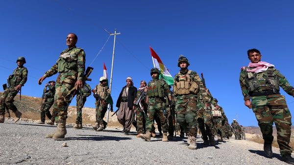 Kurdish peshmerga forces enter the northern Iraqi town of Sinjar on Friday after pushing out the Islamic State. The town is home to the Yazidi minority; many displaced members of the group say they are wary of returning home. They fear they could still be targeted by neighboring communities that supported the Islamic State.