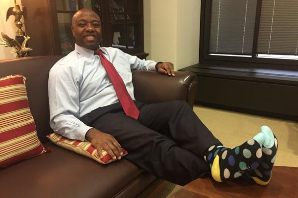 "At his office in Washington, D.C., Scott shows off his socks. ""It's dreary outside,"" he says, ""but it's sunny on my feet."""