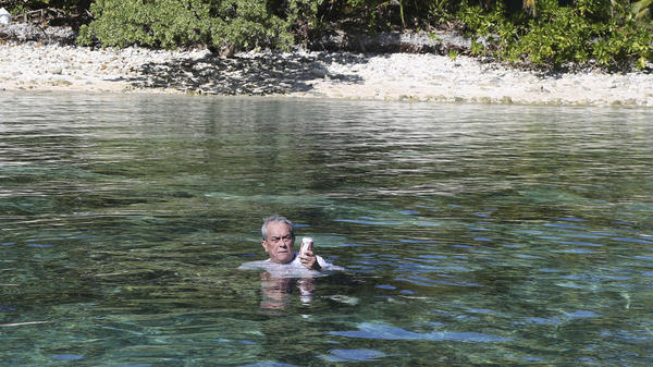 Tony de Brum, the foreign minister of the Marshall Islands, relaxes at the Majuro Atoll last month. Climate change poses an existential threat to places like the Marshall Islands, which rise no higher than 6 feet above sea level in most places. De Brum is representing the Marshall Islands at the climate talks in Paris.