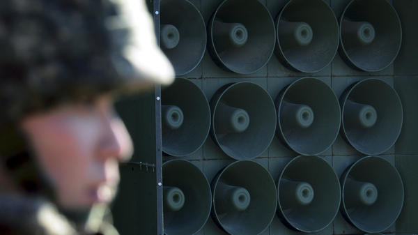 A South Korean soldier stands next to loudspeakers near the border with North Korea on Jan. 8. South Korea responded to the North's latest nuclear test by resuming the broadcasts that include news, criticism of the North Korean regime and pop music.
