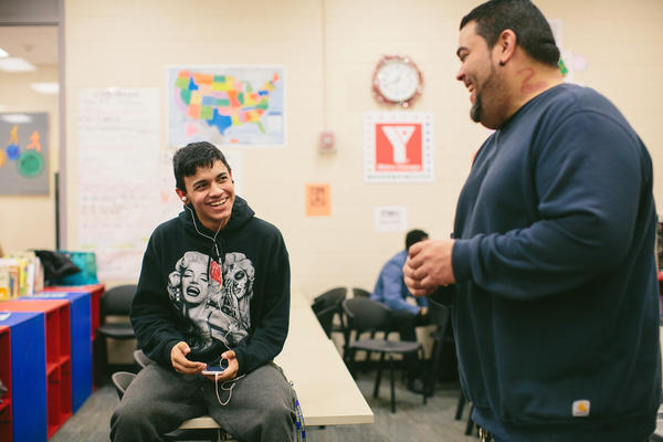 Noel Melecio, 15, talks with YMCA outreach worker John Vergara during a recent Urban Warriors session.