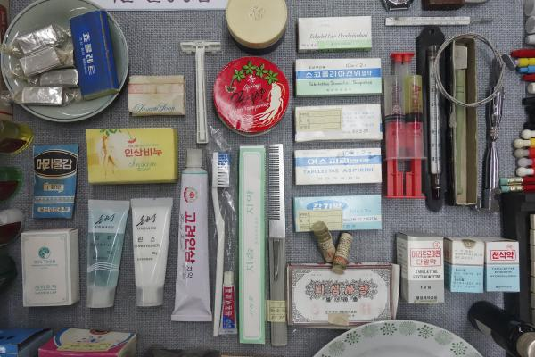 The library displays everyday items from North Korea of the 1990's. Korean <em>insam</em> (ginseng) is used in toothpaste, soap and other products.
