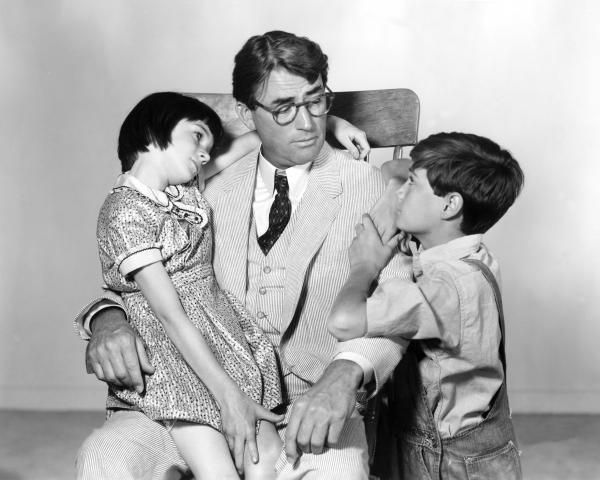 "It was recently announced that Aaron Sorkin will be adapting <em>To Kill A Mockingbird </em>for Broadway. Above, Scout's legs are tired after a particularly long ""walk and talk."" (Not really.) Above, Gregory Peck as Atticus Finch with Mary Badham as Scout and Phillip Alford as Jem in the 1962 film adaptation of Harper Lee's novel."