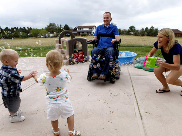 The Keils play with their twins, Matthew and Faith, at their home near Parker, Colo., in 2012.
