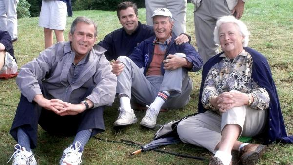 Texas governor and presidential candidate George W. Bush, Florida governor Jeb Bush, former president George H.W. Bush and his wife Barbara at the Ryder Cup golf competition in 1999.