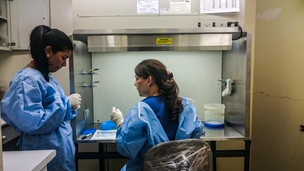 Researcher Beatriz Parra Patino (right) prepares to test the blood and urine of patients with Guillain-Barre syndrome to see if they had Zika virus as well. She's been working seven days a week, up to 14 hours a day, to test samples as quickly as possible.