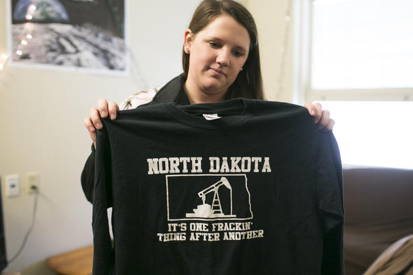 Taylor Debee, a senior petroleum engineering major at Marietta College, holds a shirt from her internship. Debee interned at Murex Petroleum Corporations in North Dakota.