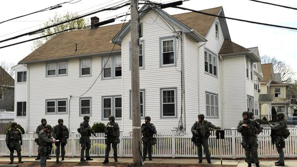 Law enforcement searches houses in Watertown days after the Boston Marathon bombing. Watertown resident Maria Van Ryn balked at the idea of <em>Patriots Day</em> re-creating the 2013 shootout in her neighborhood.