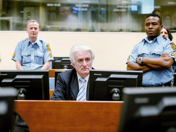 Radovan Karadzic sits in the courtroom in the Hague during the reading of his verdict at The International Criminal Tribunal for Former Yugoslavia on Thursday.