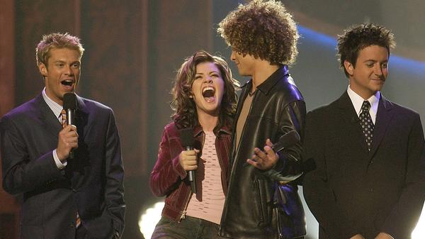 Kelly Clarkson won the first season of <em>American Idol </em>in September 2002 over Justin Guarini, in front of co-hosts Ryan Seacrest and Brian Dunkleman, who almost looks aware that this would be his only season.