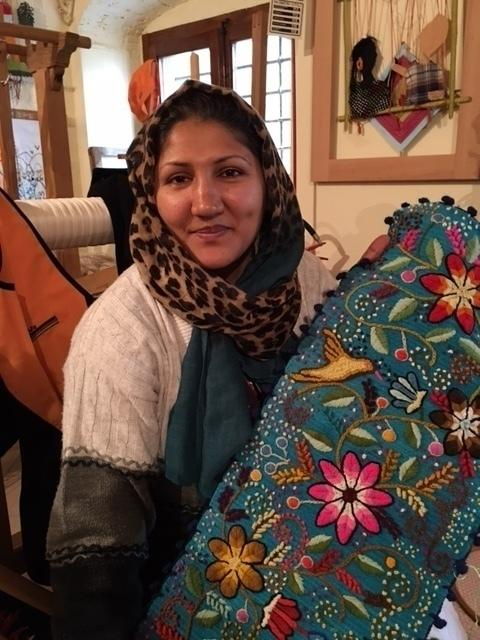 Zara Hosseini, 34, sells her embroidery in Riace. The Afghan migrant arrived in the southern Italian town three years ago.