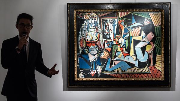 In 1997, Pablo Picasso's <em>Women of Algiers (Version O) —</em> shown here at Christie's in Hong Kong — was part of a groundbreaking art auction that sent prices soaring.