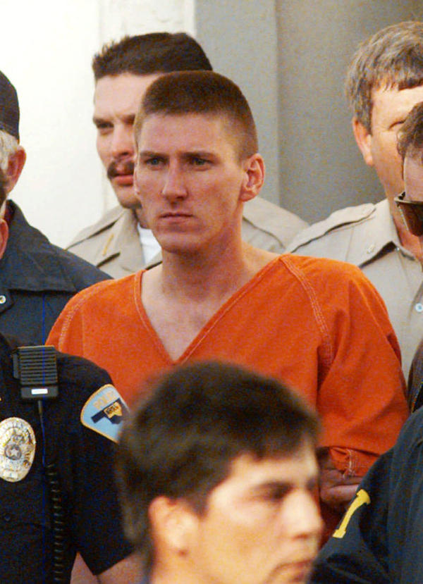 Oklahoma City bombing suspect Timothy McVeigh is escorted by law enforcement officials from the Noble County Courthouse in Perry, Okla.
