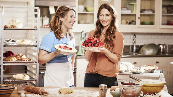 Pop singer Sara Bareilles (right) shares a moment with Jessie Mueller, star of the new Broadway musical <em>Waitress</em>, for which Bareilles wrote the score.