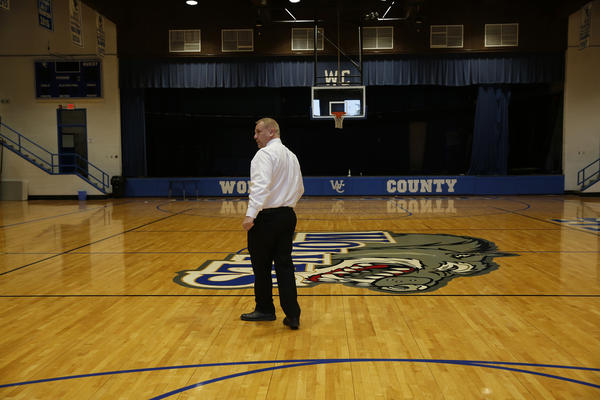 Bell, who was a basketball star when he was a student at Wolfe County High School, gives a tour of the gym.
