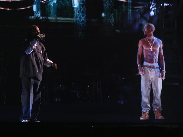 Snoop Dogg (left) performs with a hologram of the late rapper Tupac Shakur at the 2012 Coachella festival in Indio, Calif.